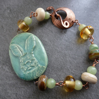 green ceramic hare, lampwork and copper bracelet