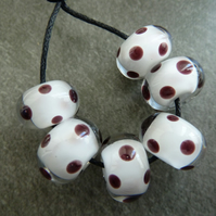white encased black spot lampwork glass beads