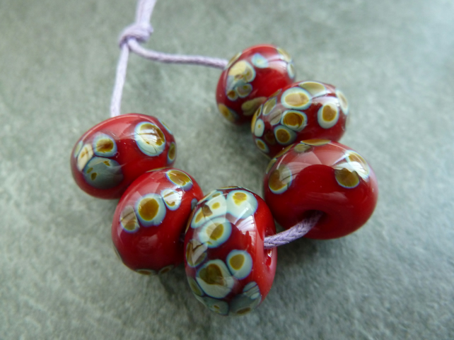 red raku handmade lampwork glass beads