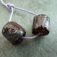 purple wrapped barrel lampwork glass beads