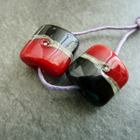 red and black lampwork glass beads