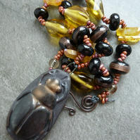 copper, lampwork glass and ceramic beetle necklace