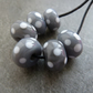 grey and white polka dot beads