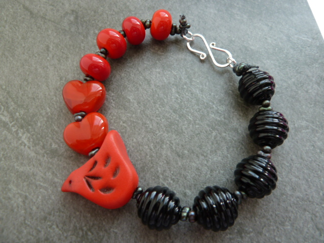 red and black lampwork bird bracelet