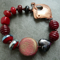 red celtic bracelet