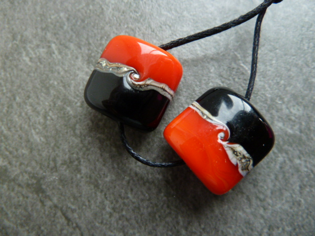 lampwork beads, orange - red and black
