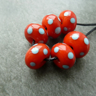 orange and blue spot lampwork glass beads