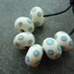ivory and turquoise spot lampwork glass beads