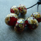 red raku lampwork glass beads