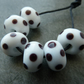 white and black spot lampwork glass beads