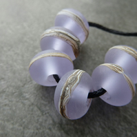 lilac wrapped lampwork glass beads
