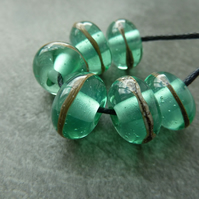 green wrapped lampwork glass beads