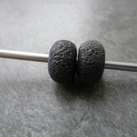 black pitted lampwork glass beads