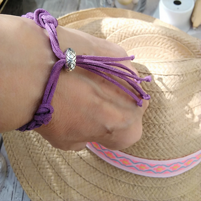 Faux Suede purple Braided Bracelet with Silver plated bead.