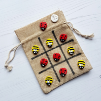 Retro themed tic tac toe Ladybirds and Bees