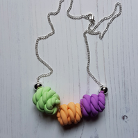 """Sugar Free"" rope knots style beaded necklace - purple, orange, green"