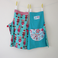 Nutcracker and Flowers Reversible Apron - Aqua, Pink and Red