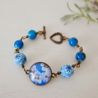 Blue Bracelet with Flowers Beads and Floral Art Print
