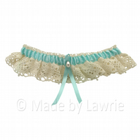 Vintage lace wedding garter with turquoise blue ribbon and pearls