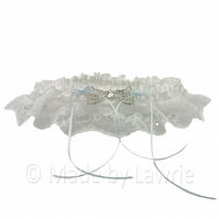 Vintage lace wedding garter with diamante bow and blue ribbon