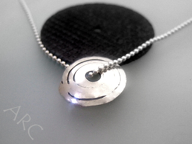 Domed spiral oxidised silver pendant