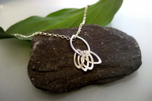 Stylised 5 leaf design pendant