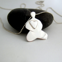 Buddha with heart pendant