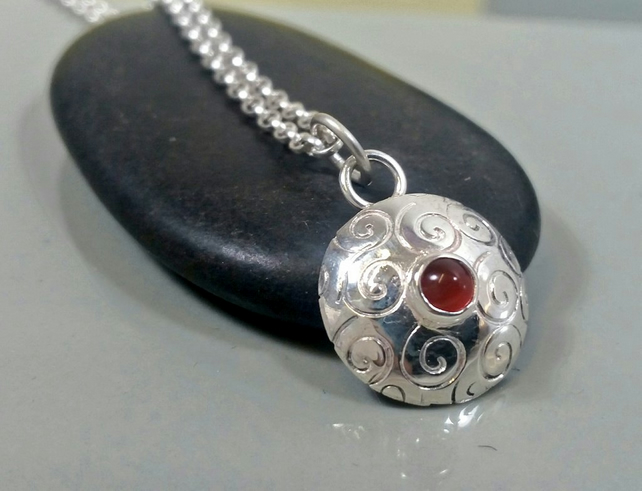 Domed sterling silver design pendant