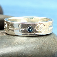Recycled sterling silver band cross and spiral design with topaz