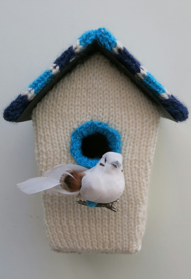 Blue knitted bird house