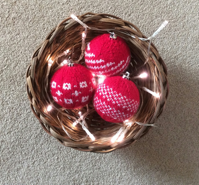 3 red and white knitted baubles