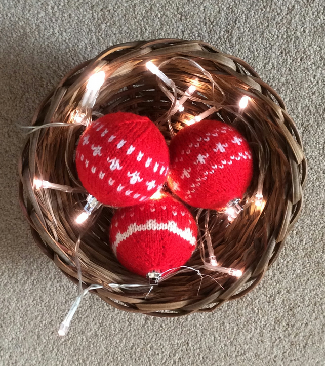 3 orange red knitted baubles
