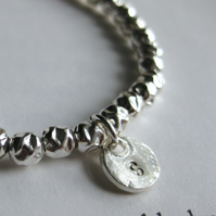 Personalised sterling silver bracelet with charm in silver, gold or rose gold