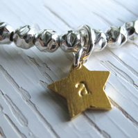 Lilla Stjärna- child's sterling silver and gold vermeil personalised bracelet