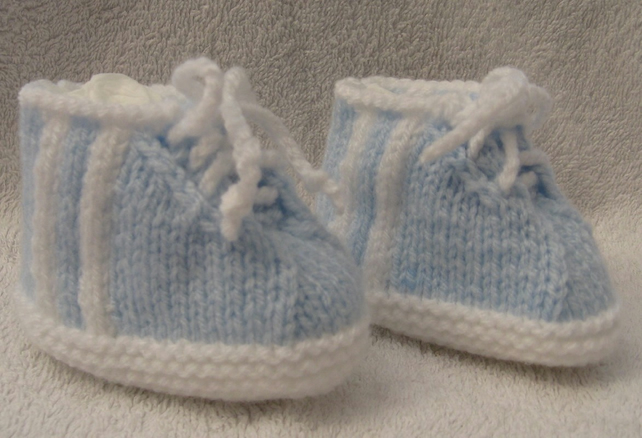 hand knitted trainer style baby booties in blue and white
