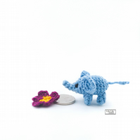 Miniature blue baby elephant and primrose flower crocheted by Lily Lily Handmade