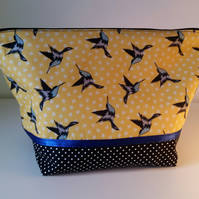 Bird print cosmetic bag.