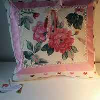 Decorative cushion with boarders and beads