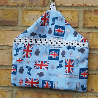 Peg bag in blue Queen themed fabric.
