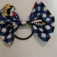Hair bobble bow in cup cake fabric.