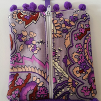 Coin purse keyring in purple pattern fabric.
