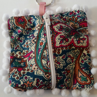 Coin purse keyring in teal and cherry red pattern fabric.