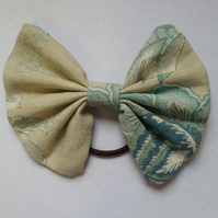 Hair bobble bow in cream and teal floral fabric. 3 for 2 offer.