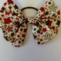 Hair bobble bow in cream Christmas stars fabric. Free uk delivery.