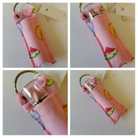 Lipstick bag charm, keyring in fruit salad fabric.