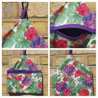 Peg bag in pink and purple floral fabric.