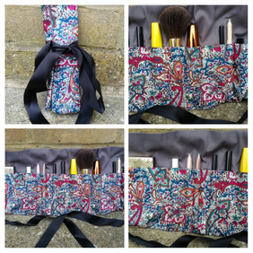 Makeup wrap in teal and cherry red fabric.