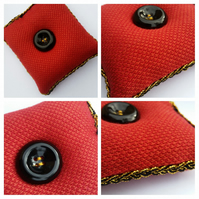 Pin cushion in red with black and gold trim