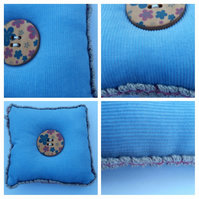 Pin cushion in blue with button