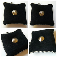 Pin cushion in black corduroy with silver trim